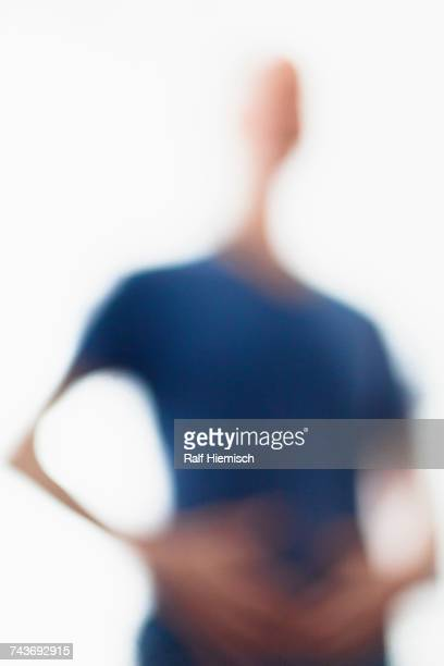Defocused image of person wearing blue t-shirt