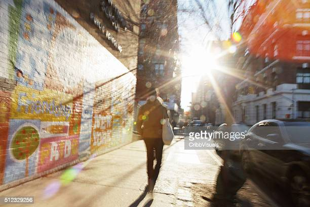 Defocused image of sun rising down NYC backstreet