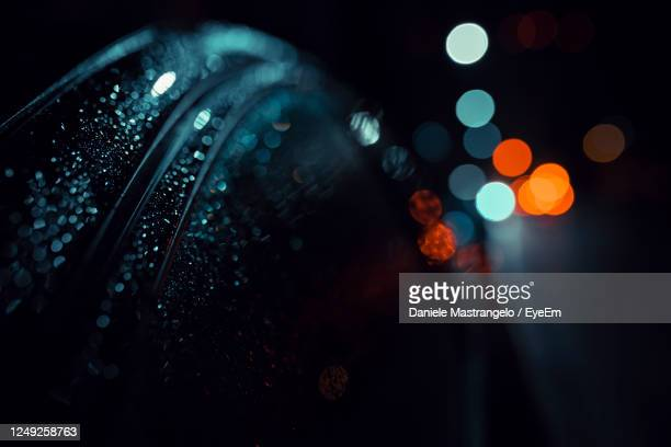 defocused image of wet car and lights - big data stock pictures, royalty-free photos & images