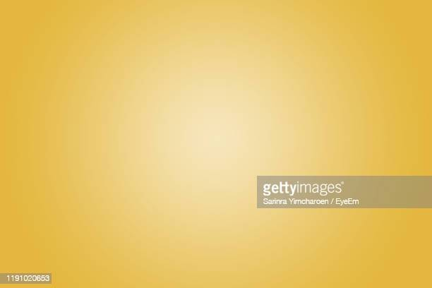 defocused image of yellow abstract backgrounds - yellow background stock pictures, royalty-free photos & images