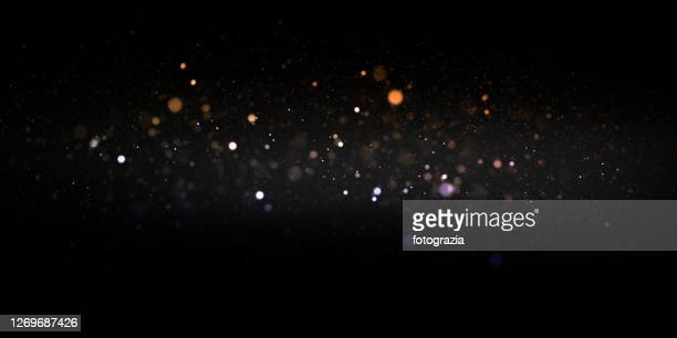defocused lights and dust particles - lighting equipment stock pictures, royalty-free photos & images