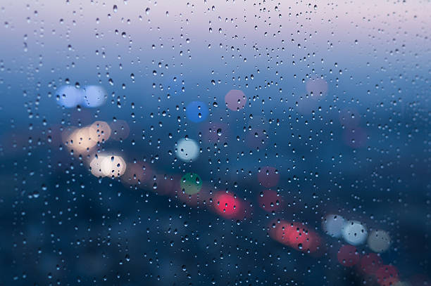Defocused Lights And Water Droplets On Rainy Wet Window Wall Art