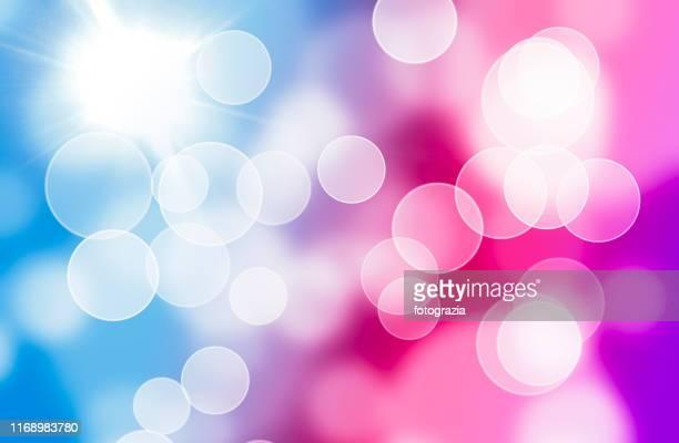 defocused lights background - blue pink - reflejo efecto de luz fotografías e imágenes de stock