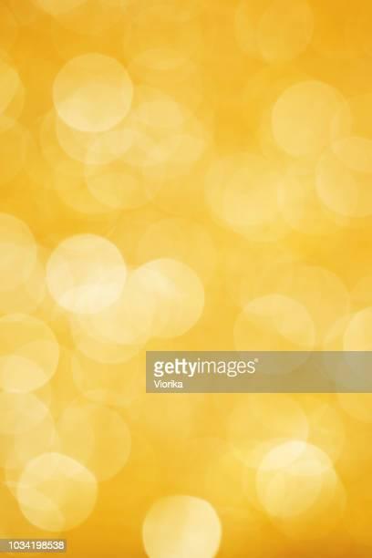 fundo desfocado de luzes (ouro - texturizado efeito fotográfico - fotografias e filmes do acervo