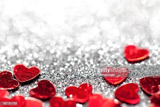 Desenfocado luces Glitter corazones de San Valentín amor