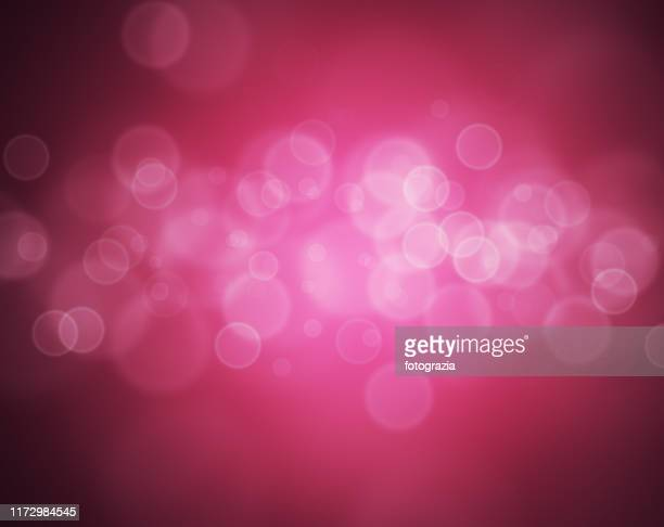 defocused lights - pink sparkles stock pictures, royalty-free photos & images
