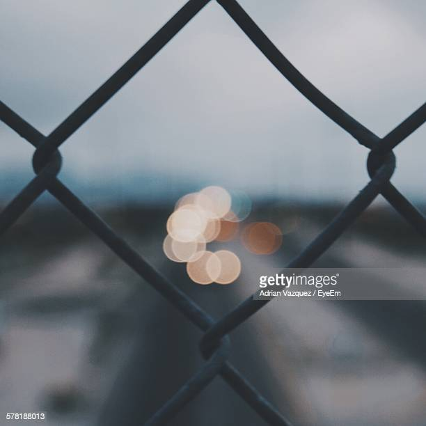 Defocused Lights Seen Through Chainlink Fence