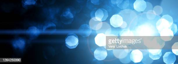 defocused lights - stock illustration. blue dusty defocused lights over dark backdrop. christmas and new year concept - celebratory event stock pictures, royalty-free photos & images