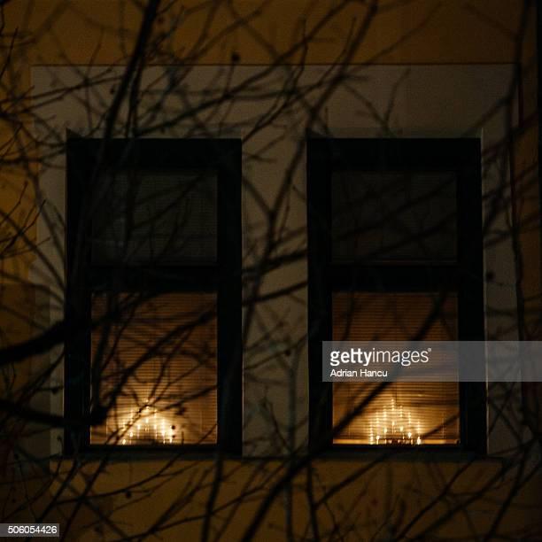 Defocused menorah in a window