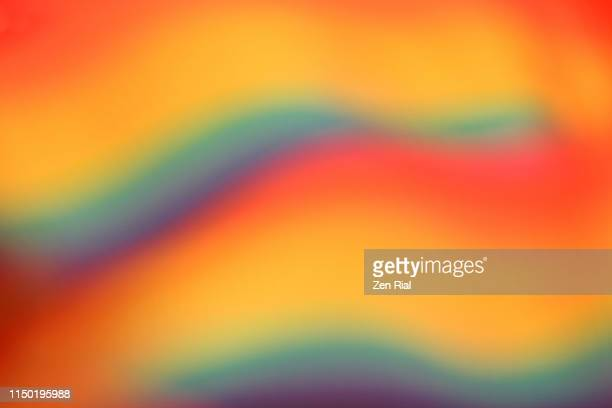 defocused multicolored belt creating wave patterns - rainbow stock pictures, royalty-free photos & images