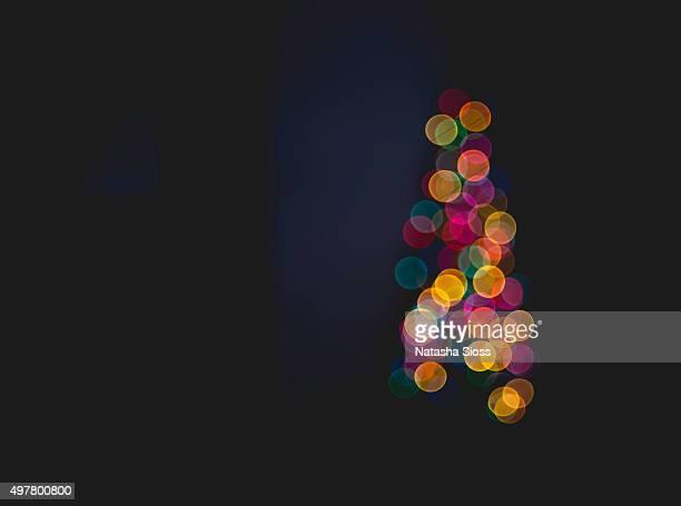 Defocused multi-colored Christmas lights on a tree