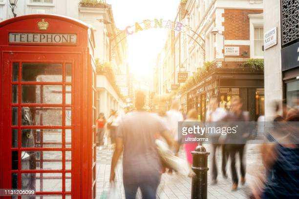 defocused people walking in carnaby shopping district in london - west end london stock pictures, royalty-free photos & images