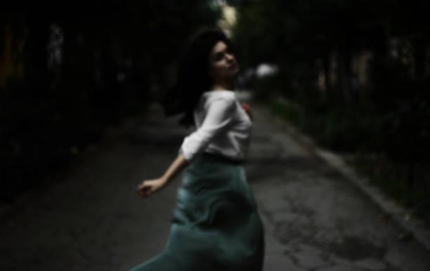 Defocused photo of woman running on the street