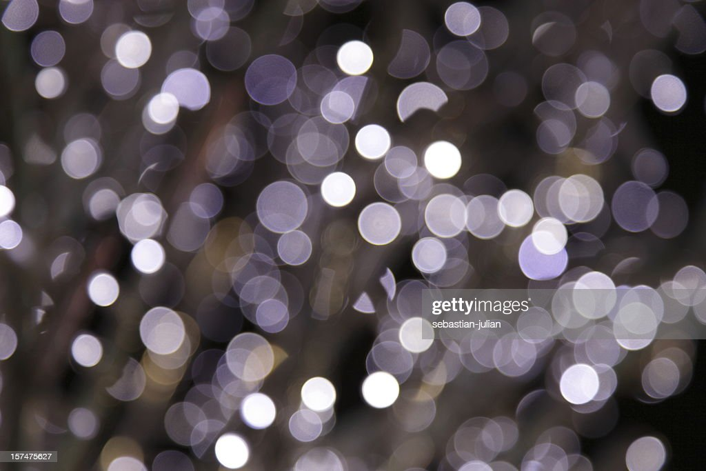 defocused purple light dots : Stock Photo