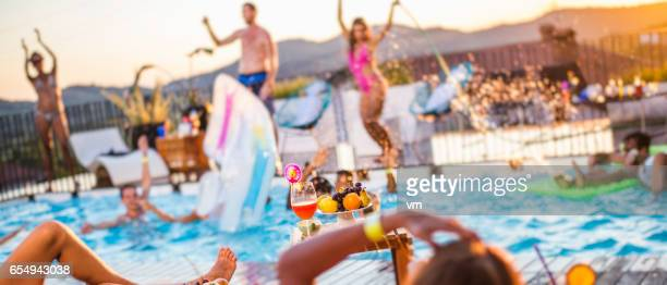 defocused shot of a pool party - pool party stock pictures, royalty-free photos & images
