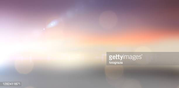 defocused sunset - lens flare stock pictures, royalty-free photos & images