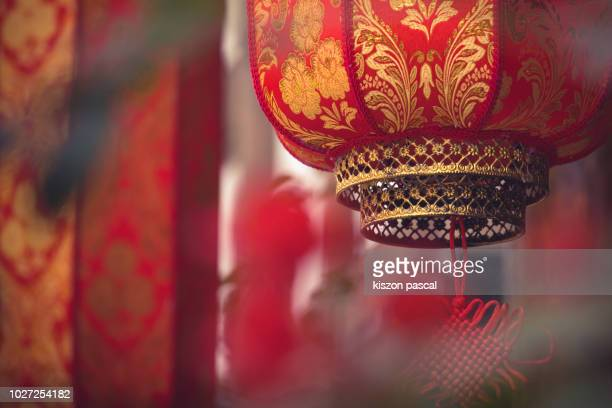 defocused view of chinese red lantern in the street - chinese new year stock pictures, royalty-free photos & images