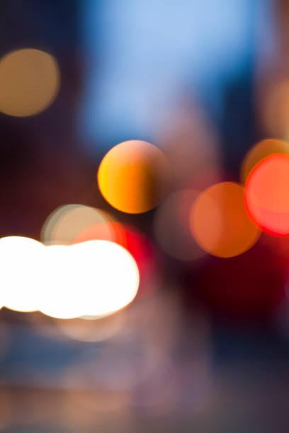 Defocused View Of City Lights At Night Wall Art