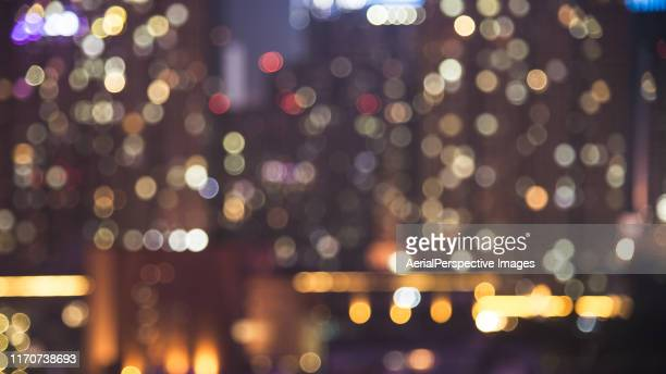 defocused view of residential building at night - building story stock pictures, royalty-free photos & images