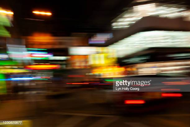 defocussed city lights at night - lyn holly coorg stock pictures, royalty-free photos & images