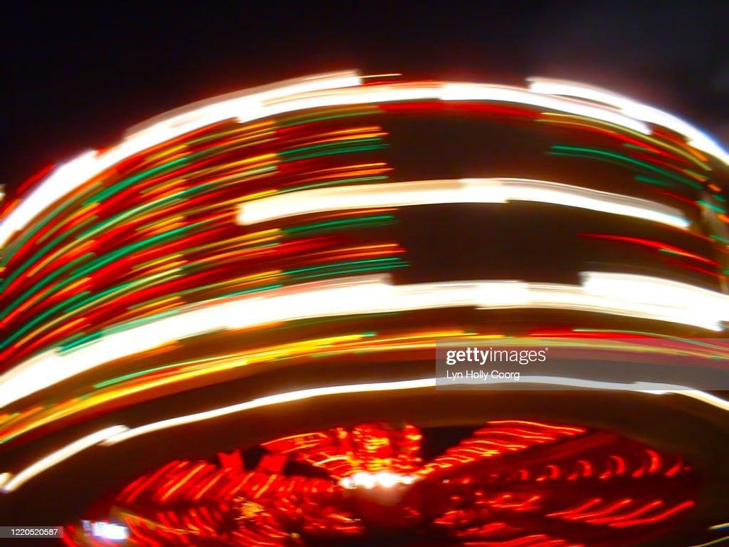 Defocussed fairground ride at speed : Stock Photo