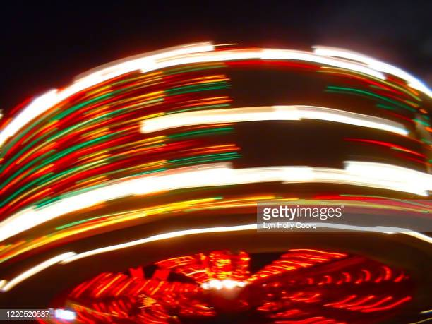 defocussed fairground ride at speed - lyn holly coorg stock pictures, royalty-free photos & images