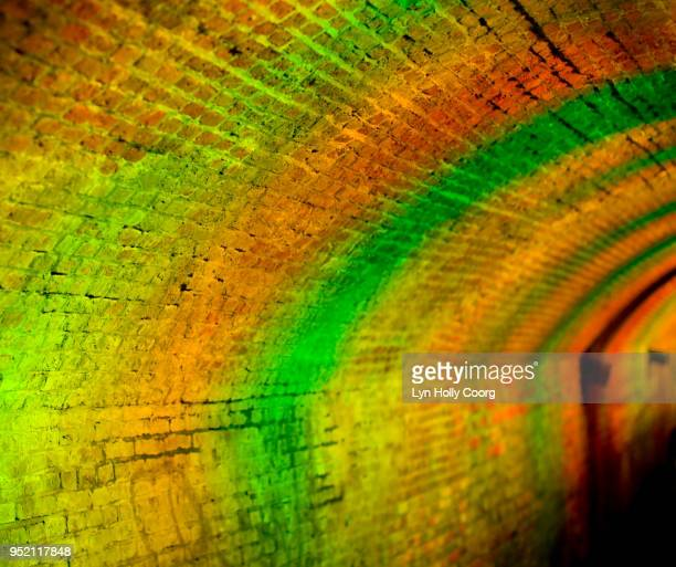 defocussed orange and green lights at night in tunnel - lyn holly coorg stock pictures, royalty-free photos & images