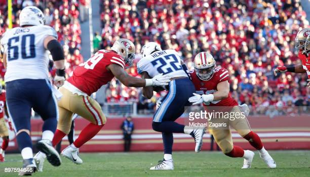 DeForest Buckner and Brock Coyle of the San Francisco 49ers tackle Derrick Henry of the Tennessee Titans during the game at Levi's Stadium on...
