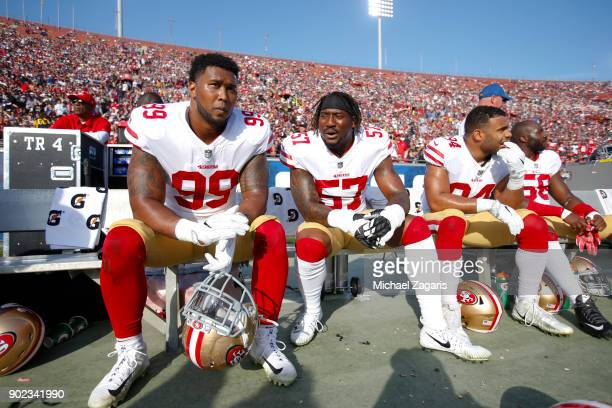DeForest Buckner Eli Harold Solomon Thomas and Elvis Dumervil of the San Francisco 49ers sit on the bench during the game against the Los Angeles...