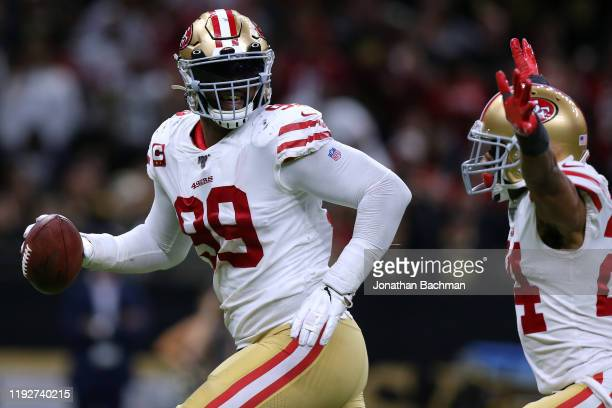 DeForest Buckner of the San Francisco 49ers and K'Waun Williams celebrate a recovered fumble against the New Orleans Saints during the second half of...