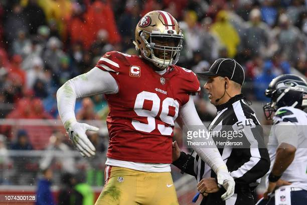 DeForest Buckner of the San Francisco 49ers celebrates after a sack of Russell Wilson of the Seattle Seahawks during their NFL game at Levi's Stadium...