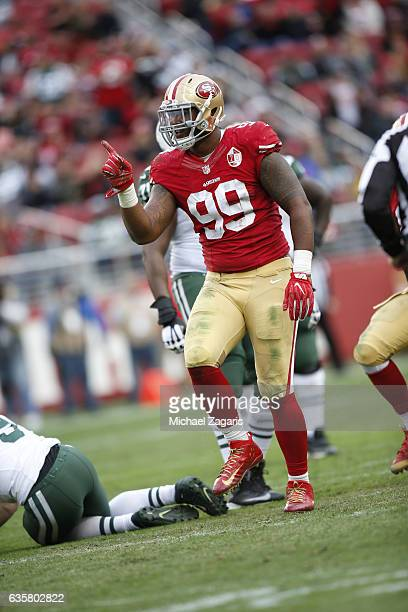DeForest Buckner of the San Francisco 49ers celebrates after sacking Bryce Petty of the New York Jets during the game at Levi Stadium on December 11...