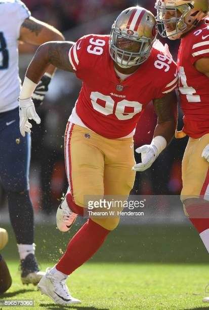 DeForest Buckner of the San Francisco 49ers celebrates after sacking quarterback Marcus Mariota of the Tennessee Titans during their NFL football...