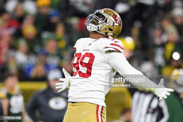 DeForest Buckner of the San Francisco 49ers reacts to a defensive stop during a game against the Green Bay Packers at Lambeau Field on October 15...