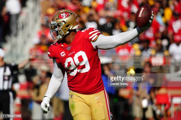 DeForest Buckner of the San Francisco 49ers reacts to recovering a fumble during the second half against the Pittsburgh Steelers at Levi's Stadium on...