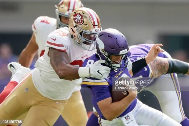 DeForest Buckner of the San Francisco 49ers sacks Kirk Cousins of the Minnesota Vikings during the game on September 9 2018 at US Bank Stadium in...