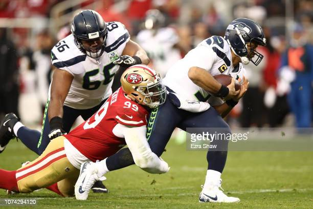 DeForest Buckner of the San Francisco 49ers sacks Russell Wilson of the Seattle Seahawks during their NFL game at Levi's Stadium on December 16, 2018...