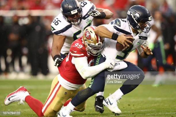 DeForest Buckner of the San Francisco 49ers sacks Russell Wilson of the Seattle Seahawks during their NFL game at Levi's Stadium on December 16 2018...