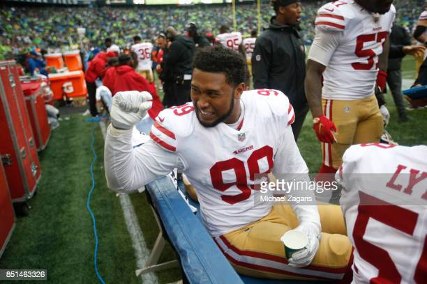 DeForest Buckner of the San Francisco 49ers sits on the bench during the game against the Seattle Seahawks at CenturyLink Field on September 17 2017...