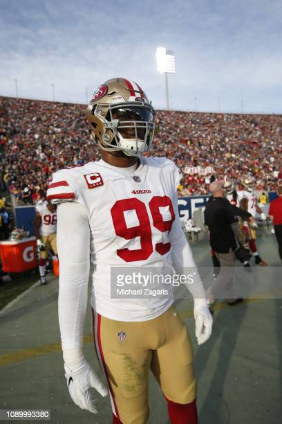DeForest Buckner of the San Francisco 49ers stands on the sideline during the game against the Los Angeles Rams at the LA Memorial Coliseum on...