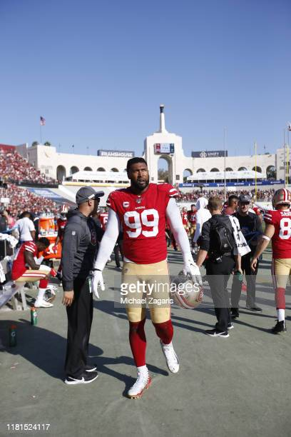 DeForest Buckner of the San Francisco 49ers stands on the sideline during the game against the Los Angeles Rams at the Los Angeles Memorial Coliseum...