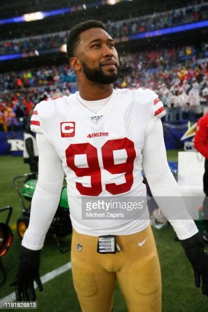 DeForest Buckner of the San Francisco 49ers stands on the sideline prior to the game against the Baltimore Ravens at MT Bank Stadium on December 1...
