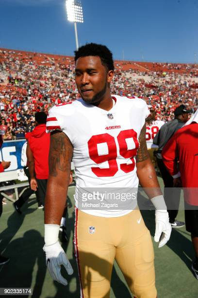 DeForest Buckner of the San Francisco 49ers stands on the sideline prior to the game against the Los Angeles Rams at Los Angeles Memorial Coliseum on...