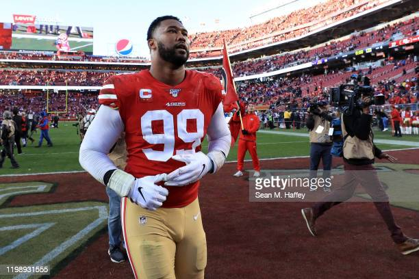 DeForest Buckner of the San Francisco 49ers walks off the field after winning the NFC Divisional Round Playoff game against the Minnesota Vikings at...