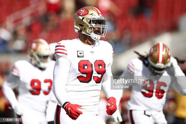 DeForest Buckner of the San Francisco 49ers warms up prior to the game against the Carolina Panthers at Levi's Stadium on October 27 2019 in Santa...