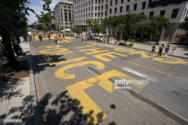 Defund the Police is painted on the street in Black Lives Matter Plaza near the White House in Washington DC US on Sunday June 14 2020 Atlanta Police...