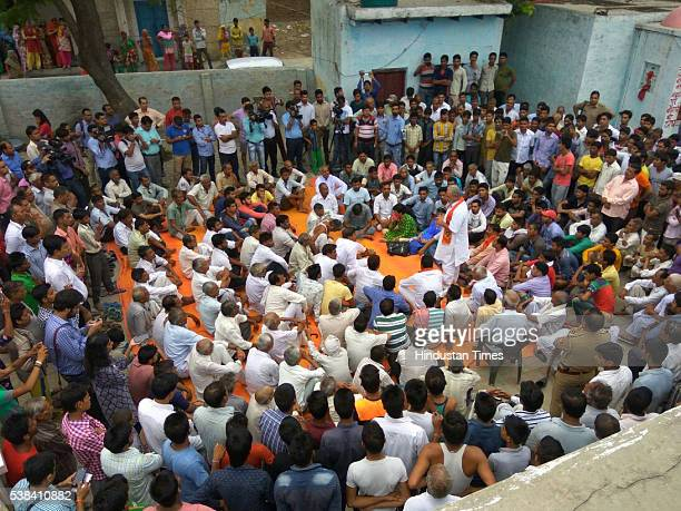Defying the prohibitory orders imposed by the district administration residents of Bishada and neighbouring villages hold a protest meeting demanding...