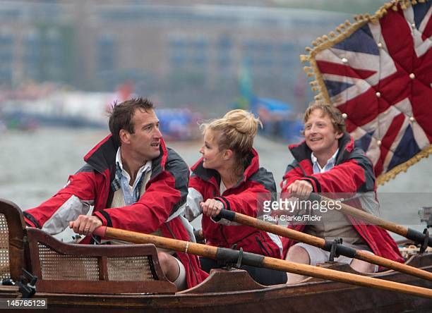 Defying the rain Ben Fogle Helen Skelton and Olly Hicks battle on to the finish and disembarkation at South Dock Surrey Quays