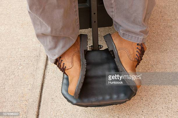 degenerated feet of a man in a wheelchair with duchenne muscular dystrophy - duchenne muscular dystrophy stock photos and pictures