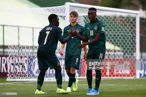 Degnand Gnonto of Italy celebrates with teammates after scoring a goal during the FIFA U17 Men's World Cup Brazil 2019 group F match Solomon Islands...